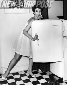 Nancy Berg in a silly pose at the fridge. 1955