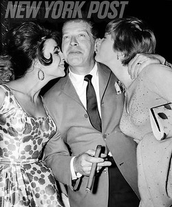 """Milton Berle is HAPPILY getting smooched by Joan Collins and Shirley Maclaine at Marilyn Monroe's """"Let's Make Love"""" sneak preview. 1960"""