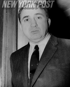 Mickey Cohen, a gangster and member of the Jewish Mafia with strong ties to the Italian American Mafia.