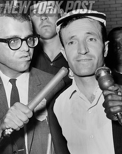 Hondo Bariam is asked by radio newsmen why he killed Quani Saraci, as he is led to police precinct. 1963