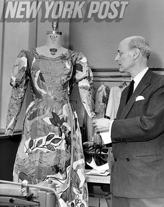 Rudolf Bing, examines this Marc Chagall design for the opera, The Magic Flute. 1966