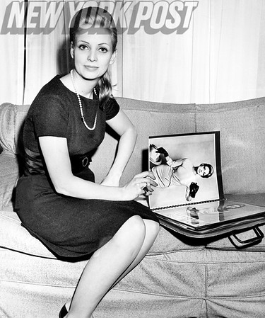 Countess Christina Paolozzi Bellin shows her look book of modeling photos. 1962