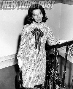 Mrs. Pierre Simon Wearing Black-Red Flecked Beige Tweed Coat With Bowed Neckline. 1963.