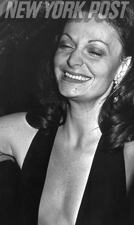Diane Von Furstenberg laughs while wearing one of her iconic plunging neckline dresses.