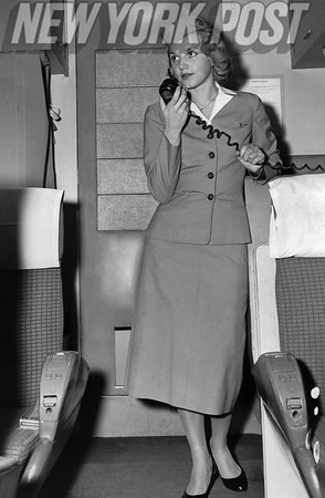 Ingerlise Pedersen on the intercom of a TWA flight from LaGuardia Airport. 1956
