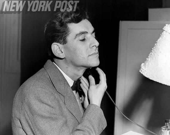 A dapper Leonard Bernstein takes a shave. 1943