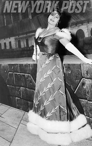 Opera Star Lucine Amara, in costume, strikes a pose. 1958
