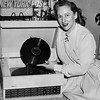 "Connee Boswell holding a record of her latest single ""If I Give My Heart to You"" 1954"