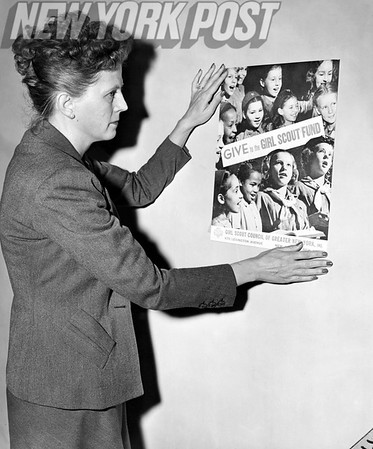 Mrs. Irving Berlin, Ellin, shows her support for the Girl Scouts of America. 1948