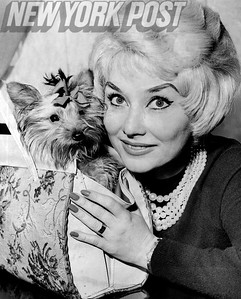 French singer Daniele Clary with her Yorkie, Wee Etoile. 1960