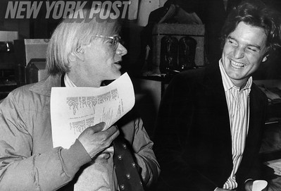 Andy Warhol and painter Jamie Wyeth have a laugh at an auction sitting. 1979