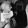 Andy Warhol and painter Jamie Wyeth have a laugh at an auction sitting