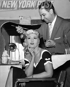 Lyda Fairbanks gets her hair styled at Northern Hotel salon. 1957