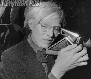 Iconic artist Andy Warhol taking a photograph. 1960s
