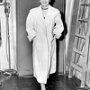 Nella Bogart Poses in Her Trench Coat. Continental Call Girl Ring. 1957
