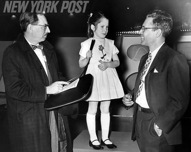 Post Reporter Vince Austin chats with Six year old Susan Stratton who pushed the button to fire the first dramatic flash and bang fusion for visiting government scientists at General Electric's World Fair Pavilion. 1964