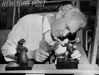 Saul Baizerman Famous Sculptor and Coppersmith, working on one of his pieces. 1940