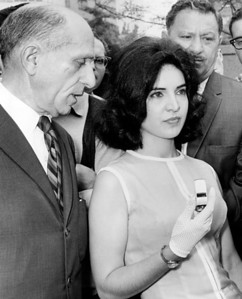 Arlene Del Fava, arrested for using a knife to fight off an attacker, displays the police whistle she says she will use to protect herself from molesters from now on. 1964