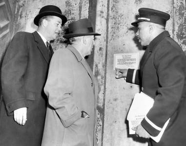 Fire Prevention Campaign (L to R) Fire commr. Cavanagh, owner Nicholas J. Guarlia watches Lt. Luther Hooey put warning sign on building. March 13, 1958.  (Photo by William N. Jacobellis/New York Post/Photo Archives, LLC )