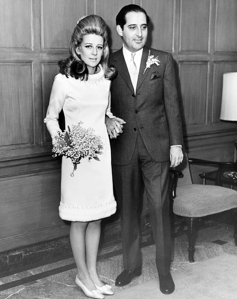 Mr. And Mrs. Giancarlo Uzielli, she's the former Anne Ford, pose for photographers immediately after their marriage. 1965