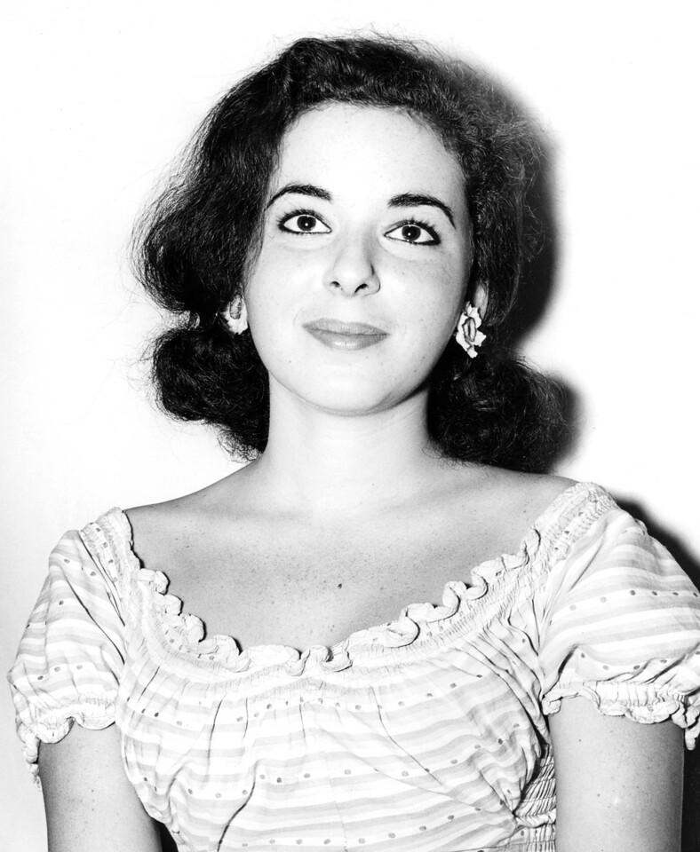 Jo Anne Warner is all smiles. 1960