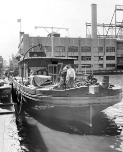 Donald and Shirley Culjak with their children Ronald and Donald living on their stake boat. 1957