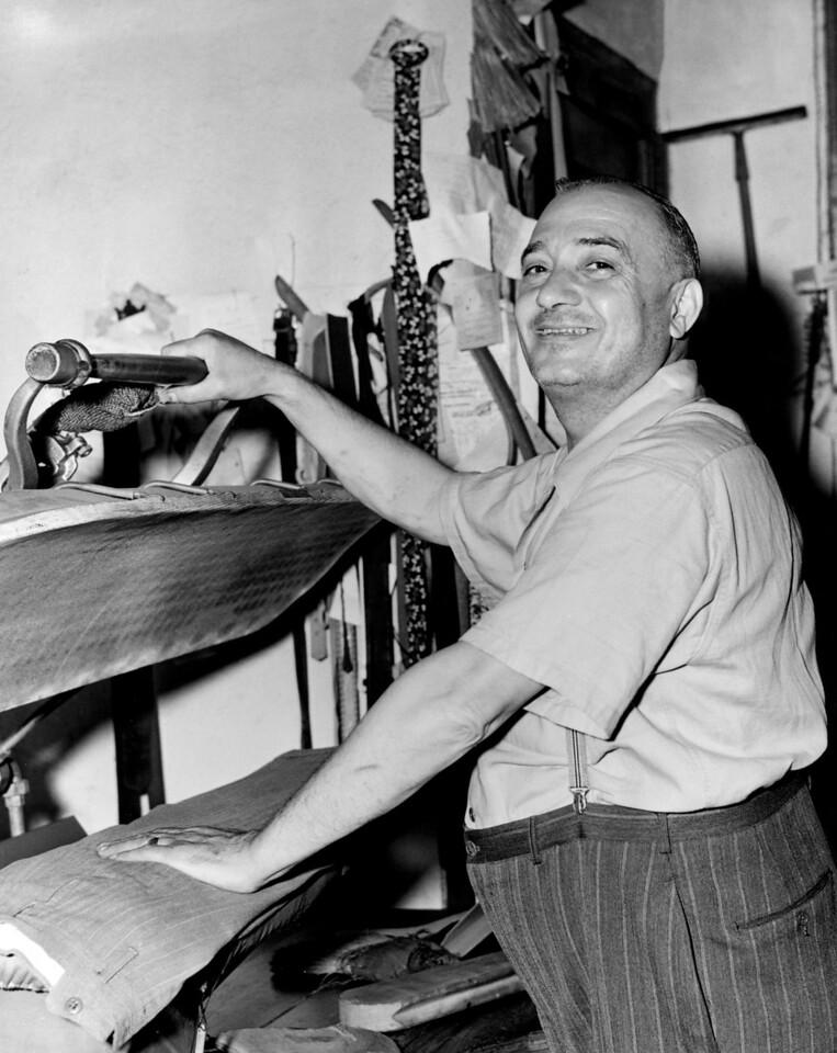 John Sally Basilone in his tailor shop. 1943