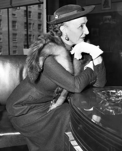 Madame Gabrielle in conversation.
