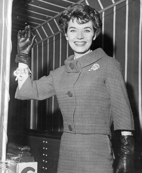 Beauty, Polly Bergen, as she waves to the camera. 1959