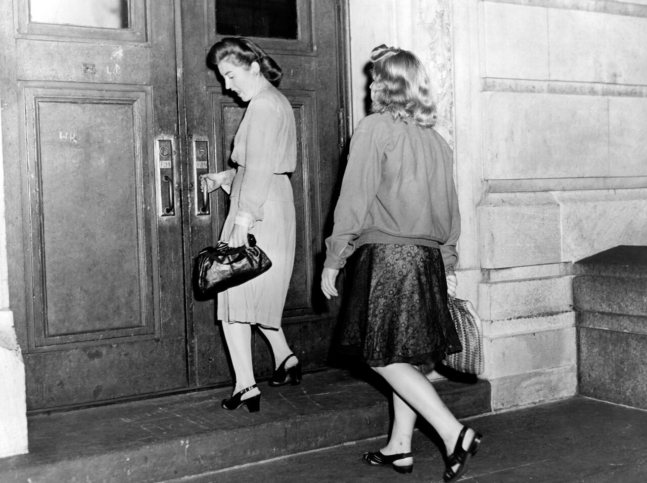 Police woman Katherine Bergin escorts a young lady to a shelter. 1945