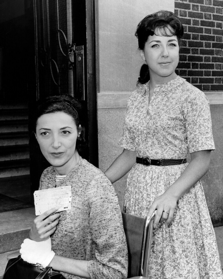 Polio victim Jacqueline Block is wheeled from Bronx Traffic Court by her Daughter Susan, 18, after she was acquitted of charge of parking too close to hydrant.