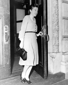 Police woman Katherine Bergin leaves the station for her assignment. 1945