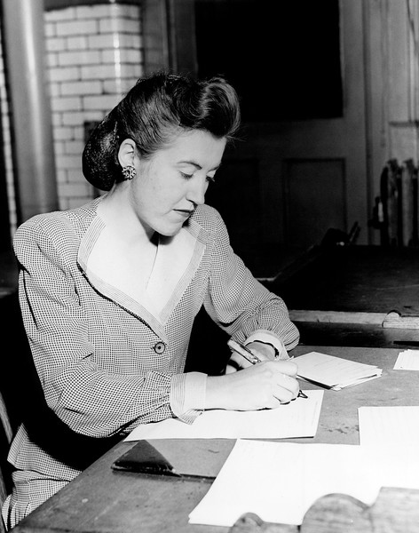 Police woman Katherine Bergin finishes her police report. 1945