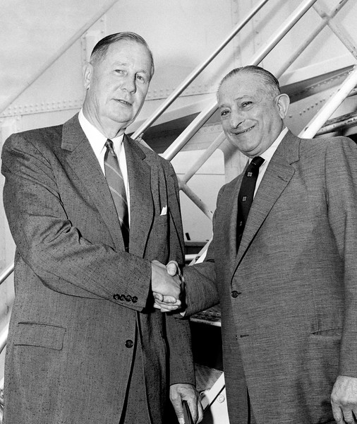 Department store heads arrive on the SS United States. Macy's and Orbach Department store heads, EV Walters and Nathan Orbach. 1956
