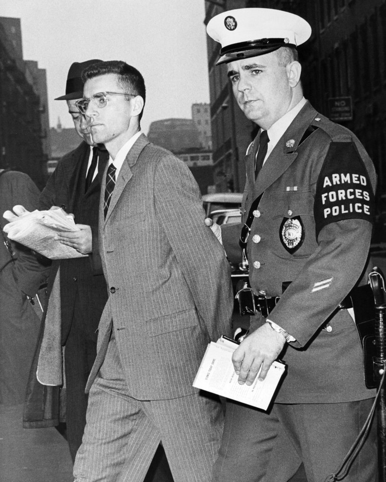 Dejected Joseph Brennan Leaving the E. 104th St. Police station in custody of the Armed Forces Police. 1965