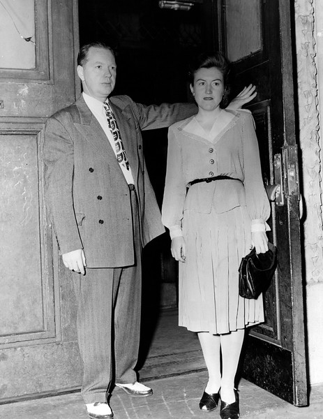 Police woman Katherine Bergin leaves the police station with Lt. McMerny. 1945
