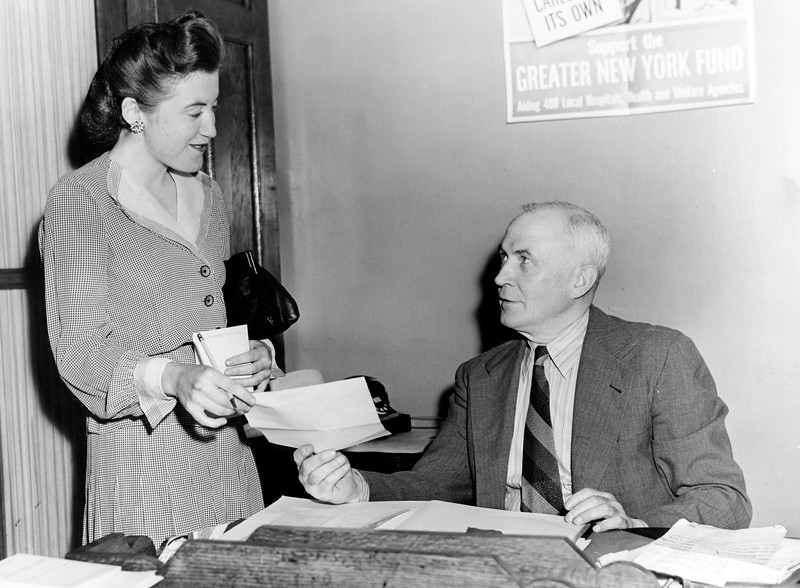 Police woman Katherine Bergin gets her assignment from Lt. McGarufy. 1945