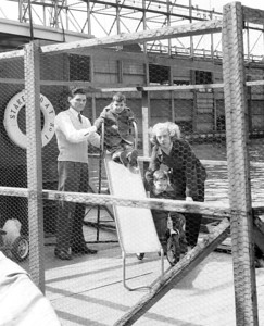 Donald Culjak with his wife Shirley and their children Donald and Ronald in play coop at stern of their boat. 1957