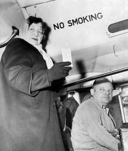Anna Gerisi holding Bus transfer she received. 1962