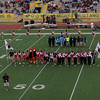 Harlingen High School Cheerleaders, Mascots, Flag Crew, and Student Council Members gather to present the opposing team a gift