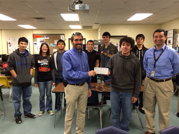 United Launch Alliance presents award winning Harlingen High School South Engineering Club/Robotics Team with a donation check.
