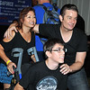 James Marsters poses with a wheelchair bound fan.