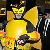 A giant bumblebee being followed by the Blues Brothers.