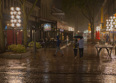 Walking Hand in Hand under Umbrellas