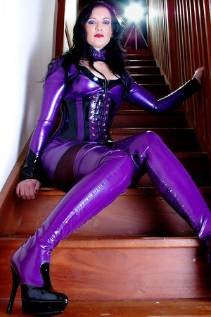 Akasha looking stunning on the stairs in her fantastic purple latex.
