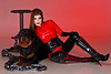 Donna looking devilish in a red latex catsuit.