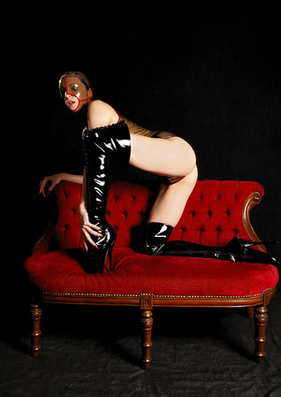 Emily Marilyn in latex and ballet boots.