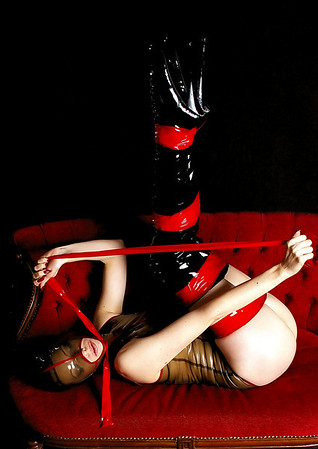 Emily in latex, bondage and ballet boots.