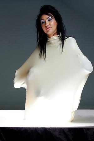 Megan inside a white latex balloon.