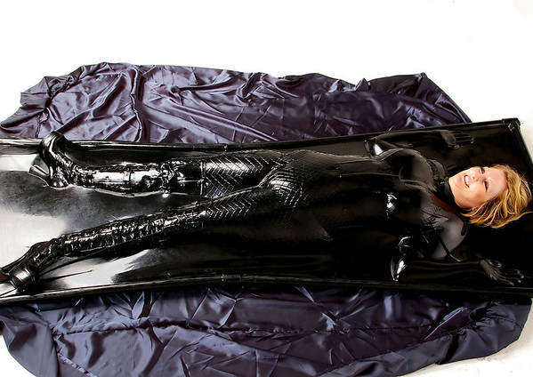 Michelle in Thigh boots, corset and latex gloves.